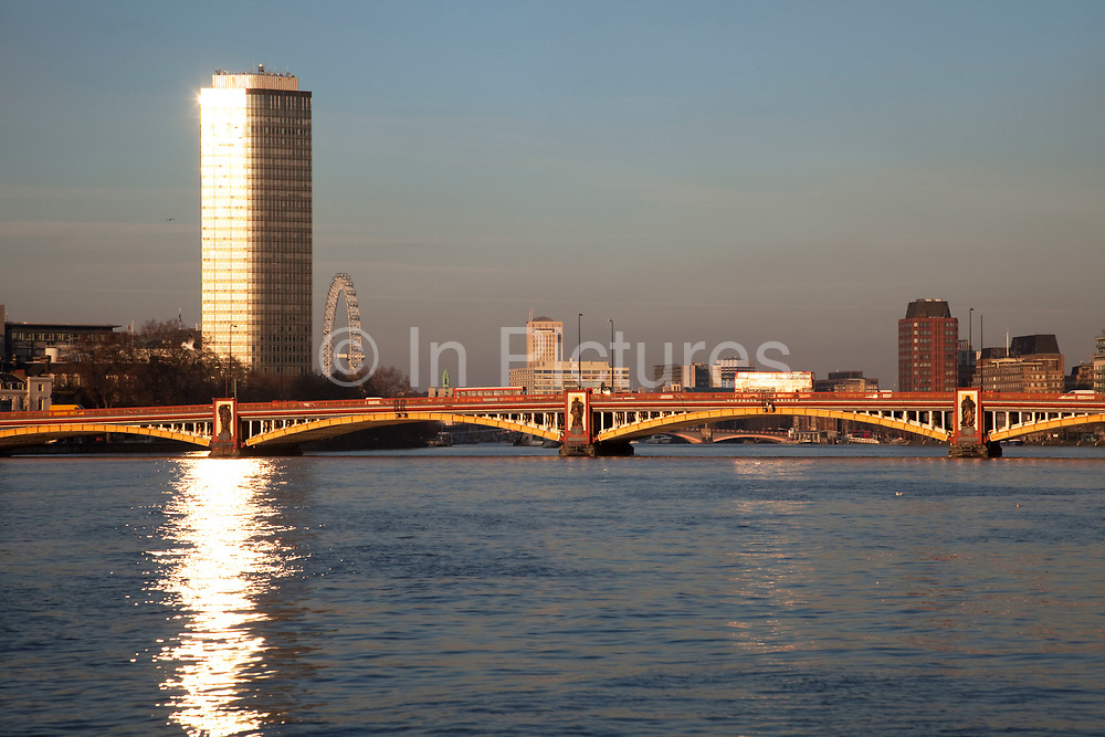 Millbank Tower glowing in the eveniing sun looing north across the River Thames and Vauxhall Bridge. Once known as Vickers Tower.