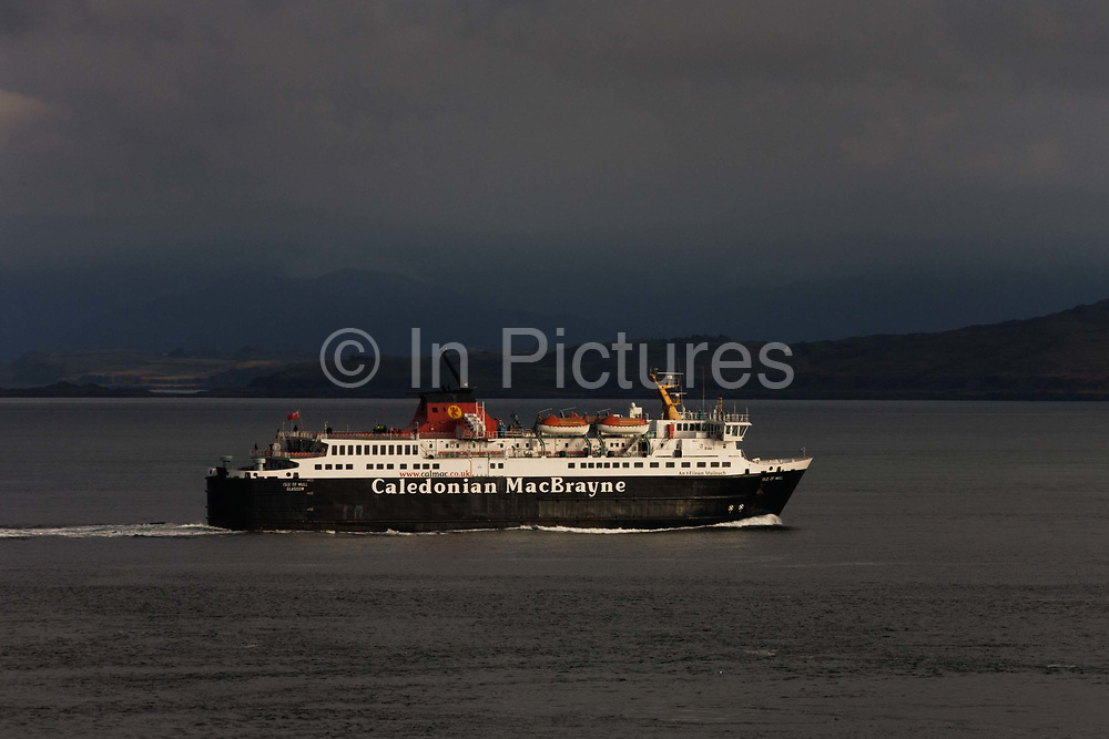 A Caledonian McBrayne ferry sails through the Sound of Mull from Craingure to Oban, seen from Duart Castle, Isle of Mull, Scotland. Caledonian MacBrayne (usually shortened to Cal Mac; Caledonian Mac a' Bhriuthainn in Scottish Gaelic) is the major operator of passenger and vehicle ferries, and ferry services, between the mainland of Scotland and 22 of the major islands on Scotland's west coast. MacBrayne's, initially known as David Hutcheson & Co., began in 1851 as a private steamship operator when G. and J. Burns.
