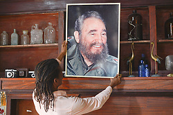 November 27, 2016 - Havana, Cuba - A man holds Castro potrait, a scene from a daily life in Havana on November 26, 2016, the next day after Fidel Castro, Cuba's historic revolutionary leader, and the former Prime Minister and President of Cuba, dies on the late night of November 25, 2016, at age of 90. . Fidel Castro died aged 90. One of the world's longest-serving rulers and modern history's most singular characters, Castro defied 11 US administrations and hundreds of assassination attempts..On Saturday, 25 November 2016, in Havana, Cuba. (Credit Image: © Artur Widak/NurPhoto via ZUMA Press)