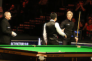 China's Ding Junhui is congratulated after completing a 147 break during his match against Neil Robertson of Australia (r). Betvictor Welsh Open snooker 2016, day 5 at the Motorpoint Arena in Cardiff, South Wales on Friday 19th Feb 2016.  <br /> pic by Andrew Orchard, Andrew Orchard sports photography.