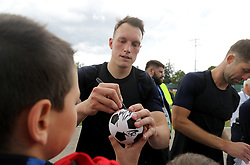 England's Phil Jones signs autographs for fans during the training session at the Spartak Zelenogorsk Stadium, Repino.