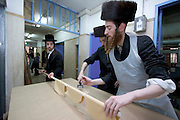 Israel, Tel Aviv, Preparing Matzah. In order for the matza to be Kosher strict baking procedures must be followed, All hand made and under a strict watch of the Rabbi April 2005