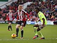 Mark Duffy of Sheffield Utd and Gabriel Zakuani of Northampton during the English League One match at Bramall Lane Stadium, Sheffield. Picture date: December 31st, 2016. Pic Simon Bellis/Sportimage