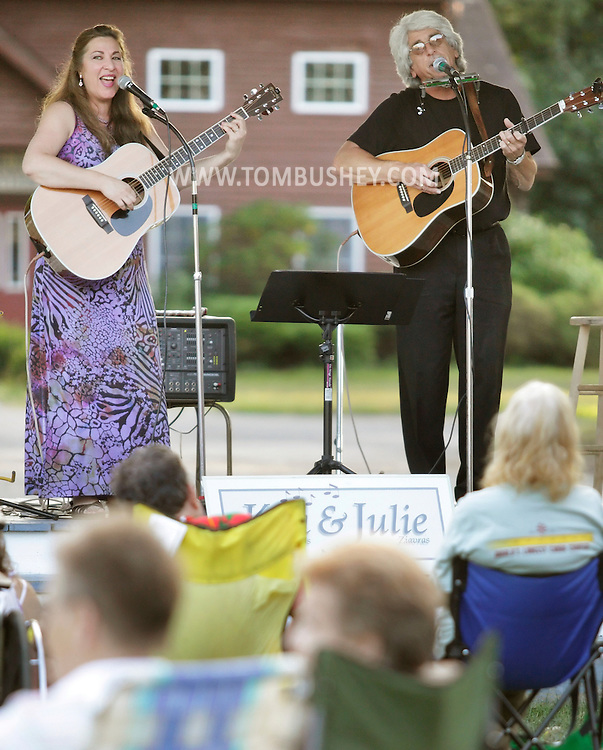 Pine Bush, New York - Singers Julie Ziavras and Ken DeAngelis perform for people outside on a summer evening on Aug. 13, 2010.