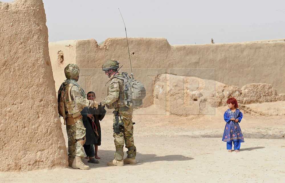 © under license to London News Pictures. 03/04/2011. Soldiers from 3 Parachute Regiment head out on patrol in the area of the Showal bazaar, Afghanistan today (26/0311).  The men from A Company are now able to step outside their patrol base and chat to the locals in an area that has seen significant change over the past six months. Phot credit should read: Alison Baskerville/LNP