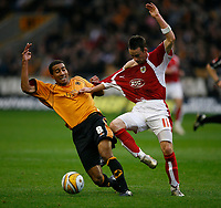 Photo: Steve Bond/Sportsbeat Images.<br />Wolverhampton Wanderers v Bristol City. Coca Cola Championship. 03/11/2007. Karl Henry (L) grabs the shirt of Michael McIndoe (R)
