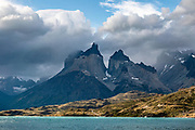Los Cuernos (The Horns) rise above Lago Pehoe, seen from Hosteria Pehoe in Torres del Paine National Park, Ultima Esperanza Province, Chile, Patagonia, South America. The Park is listed as a World Biosphere Reserve by UNESCO.