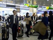 Rush hour crowds at one of Tokyo s train stations