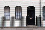 Front door of a house in London. Showing various eras of architecture. Londoner's homes.