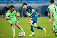 SAINT PETERSBURG, RUSSIA - NOVEMBER 04: Daler Kuzyayev of Zenit St Petersburg beats Franceso Acerbi of SS Lazio during the UEFA Champions League Group F stage match between Zenit St. Petersburg and SS Lazio at Gazprom Arena on November 4, 2020 in Saint Petersburg, Russia. (Photo by MB Media)