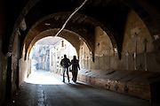 A couple walking down the street, Damascus, Syria