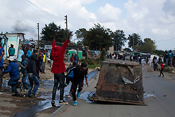 April 29, 2020, Johannesburg, Gauteng, South Africa: Protesters put a Skip bin in the road to block the complete road in Diepsloot a township at the north of Johannesburg are protesting for food as residents are starving for  days because of lock down which has been implemented by the South African government for a month. (Credit Image: © Manash Das/ZUMA Wire/ZUMAPRESS.com)