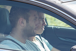 © licensed to London News Pictures. London, UK 06/08/2013. Gareth Bale (right) arriving Tottenham Hotspur FC's training ground in north London on Tuesday, August 08, 2013. Photo credit: Tolga Akmen/LNP