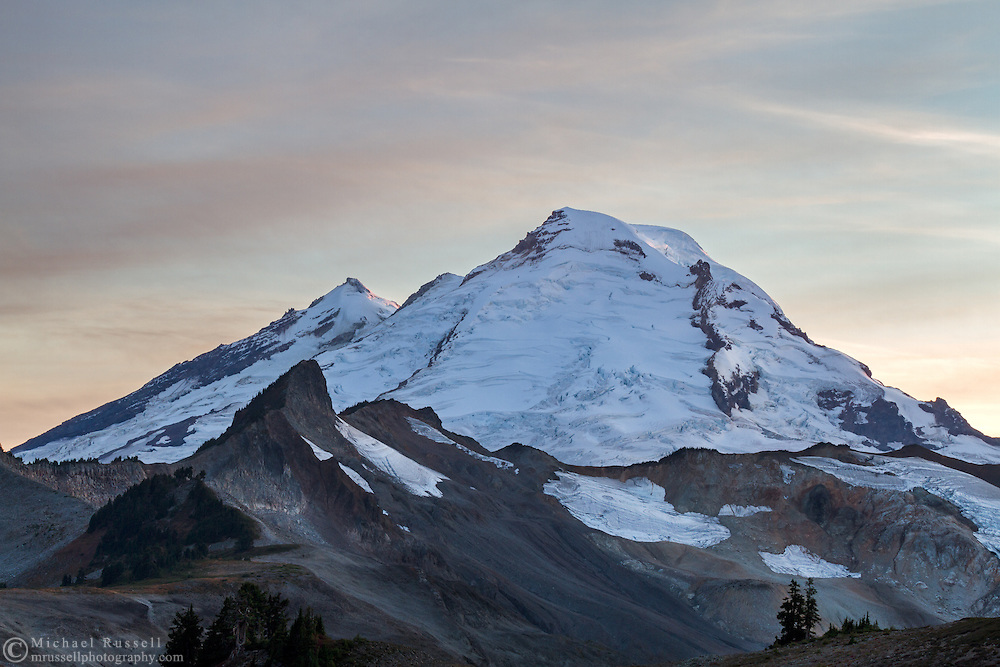 The Coleman Pinnacle and Mount Baker (L to R) in early Fall. The 2014/2015 winter had very little snow, so there is likely less snow/ice here than a typical October day.  Photographed while hiking the Chain Lakes Trail in the Mount Baker Wilderness, Washington State, USA.