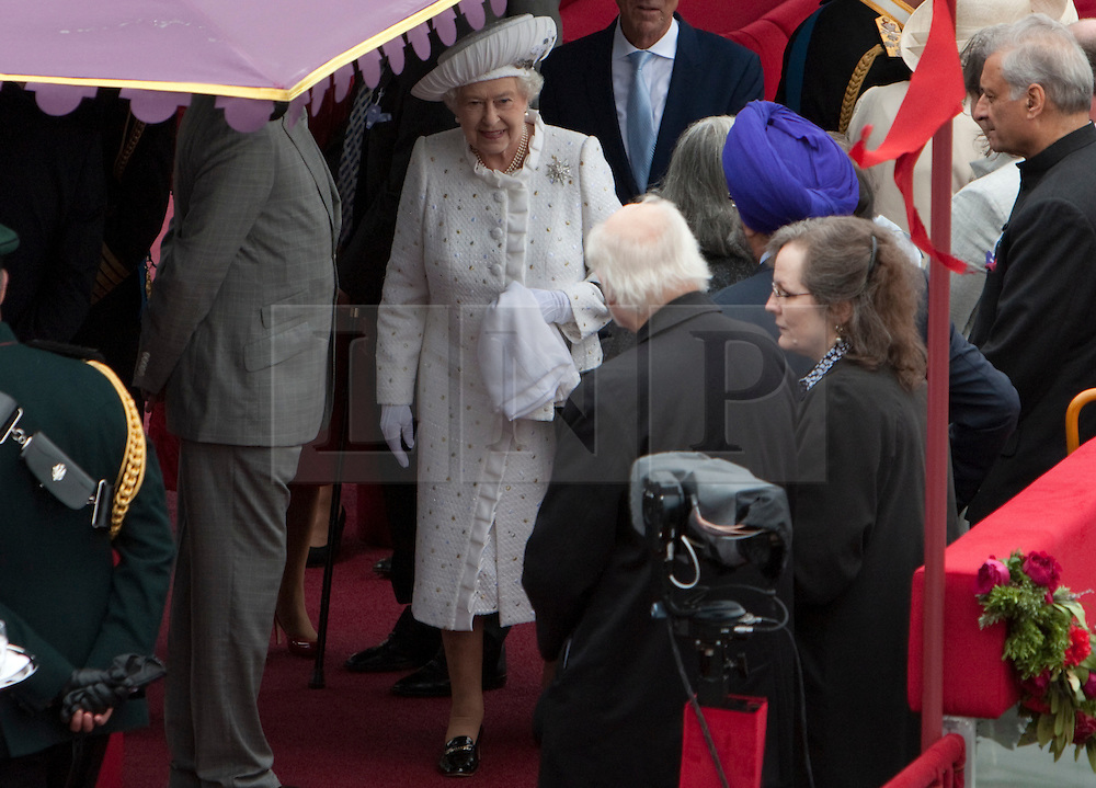 © Licensed to London News Pictures. 03/06/2012. .London, England. .Her Majesty The Queen meeting guests onboard the Royal Barge Gloriana at The Thames river pageant. The Royal Jubilee celebrations. Great Britain is celebrating the 60th  anniversary of the countries Monarch HRH Queen Elizabeth II accession to the throne this weekend Photo credit : LNP