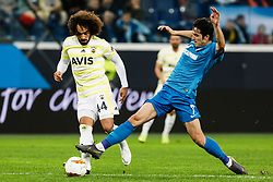 February 21, 2019 - Saint Petersburg, Russia - Sardar Azmoun (R) of FC Zenit Saint Petersburg and Sadik Ciftpinar of Fenerbahce SK vie for the ball during the UEFA Europa League Round of 32 second leg match between FC Zenit Saint Petersburg and Fenerbahce SK on February 21, 2019 at Saint Petersburg Stadium in Saint Petersburg, Russia. (Credit Image: © Mike Kireev/NurPhoto via ZUMA Press)