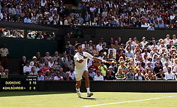 Novak Djokovic in action on day one of the Wimbledon Championships at the All England Lawn Tennis and Croquet Club, Wimbledon.