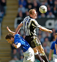 Photo. Jed Wee. Digitalsport<br /> Newcastle United v Everton, FA Barclaycard Premiership, St James' Park, Newcastle. 03/04/2004.<br /> Newcastle's Alan Shearer (R) rises over Everton's Gary Naysmith to win the ball.
