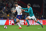 Dael Fry of England U21's on the attack being challenged by Luca Waldschmidt of Germany U21's during the U21 International match between England and Germany at the Vitality Stadium, Bournemouth, England on 26 March 2019.