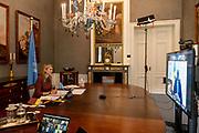 DEN HAAG, 21-01-2021, Paleis Huis ten Bosh <br /> <br /> Koningin Maxima spreekt met de Senegalese president Macky Sall over toegang tot financiele diensten tijdens een virtueel bezoek aan Senegal als speciale pleitbezorger van de secretaris-generaal van de Verenigde Naties voor inclusieve financiering voor ontwikkeling (UNSGSA). <br /> <br /> Queen Maxima speaks to Senegalese President Macky Sall about access to financial services during a virtual visit to Senegal as the United Nations Secretary-General's Special Advocate for Inclusive Finance for Development (UNSGSA).