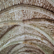 The cellarium and vaulted ceiling of Fountains Abbey, North Yorkshire, was founded by Cistercian monks in 1132 and is the largest monastic ruin in Britain. In 1987, it was awarded World Heritage status., North Yorkshire, England. 23rd July 2011. Photo Tim Clayton
