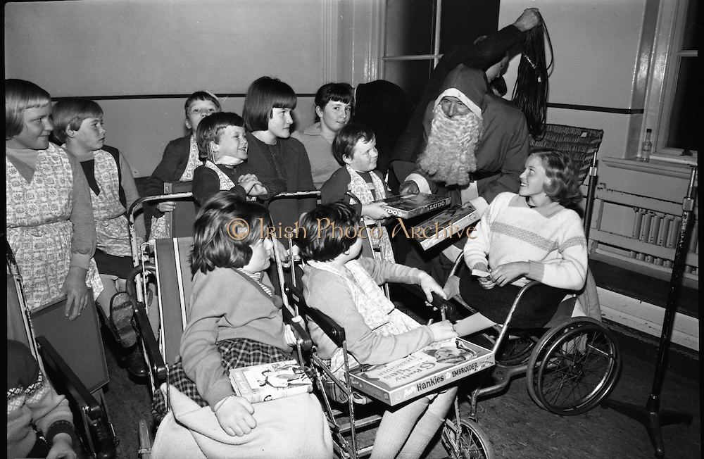 Prescott's Party for Children at St. Mary's Hospital, Baldoyle..1964..16.12.1964..12.16.1964..16th December 1964..At St Mary's Hospital in Baldoyle,Dublin, Prescotts Cleaners and Dyers sponsored a party for the disabled children who are resident there...Picture shows the highlight of the event, Santa Claus arrived with presents for the children.