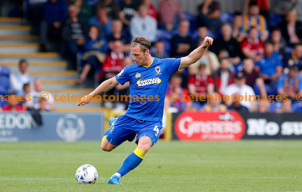 AFC Wimbledon's Dannie Bulman plays a pass during the Sky Bet League 1 match between AFC Wimbledon and Shrewsbury Town at the Cherry Red Records Stadium in Kingston. September 24, 2016.<br /> Carlton Myrie / Telephoto Images<br /> +44 7967 642437