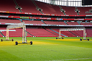 Heat lamps used to help the grass grow on the pitch of Arsenal's Emirates stadium, Islington, London, UK. 8th February 2018.