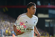 Jefferson Montero of Swansea City looks on holding the match ball. Barclays Premier League, Watford v Swansea city at Vicarage Road in London on Saturday 12th September 2015.<br /> pic by John Patrick Fletcher, Andrew Orchard sports photography.