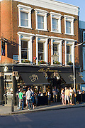 Customers enjoying warm weather at The Princess traditional London pub in Chalcot Road, Primrose Hill, London