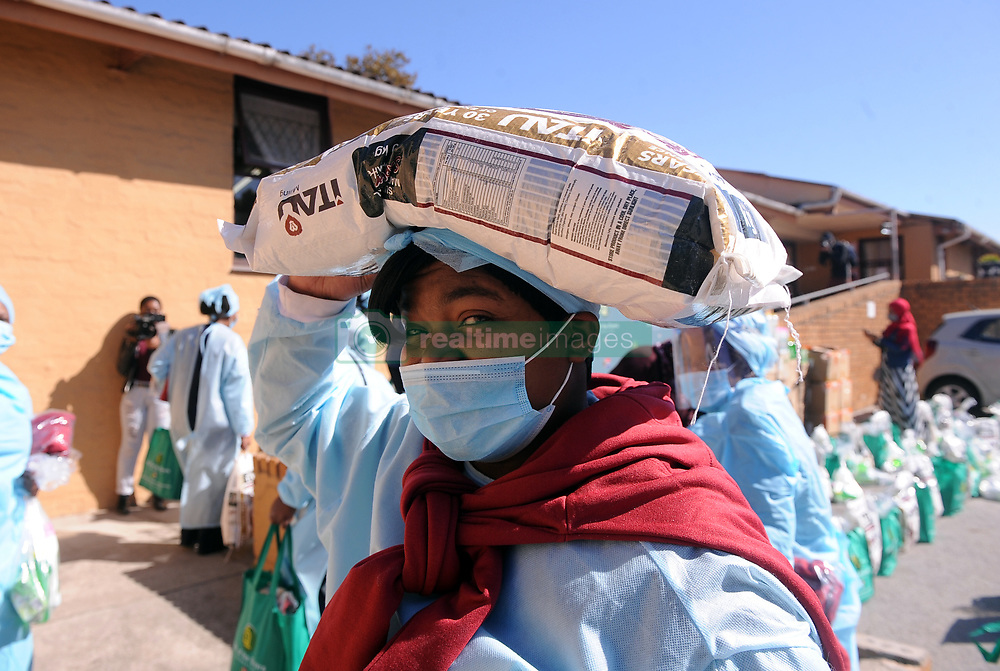 South Africa - Port Elizabeth - 12 - August - 2020 Nurse at Gelvan Park Old age home Nokuthula Mazibukwana . Gift of the Givers hand over of 100 food parcels to the care givers of Gelvan Park Frail care centre.  This home has been brought to our attention by Mrs Giezma Johsnstone of ISUZU SA. Saluting the care givers of this home who has not been paid since lockdown as subsidies was delayed but yet they came every day to work to make sure the elderly nappies were changed, bathed and fed while there families were hungry at home. These are true heroes and Gift of the Givers  will be giving each nurse a food hamper,blanket,hygiene packs and fleece jacket. Will be donating bulk food the home as well. Photographer Ayanda Ndamane African News Agency (ANA)