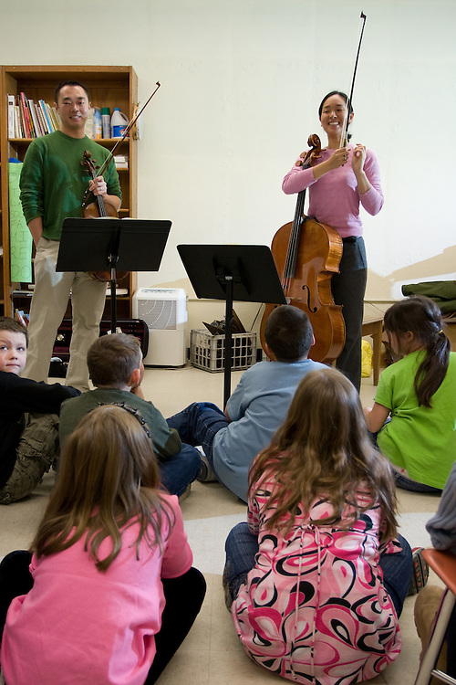 Violist Burchard Tang and cellist Priscilla Lee talk to children at the Metcalf School in Exeter, Rhode Island. Tang and Lee were performers in the Kingston Chamber Music Festival in 2008.