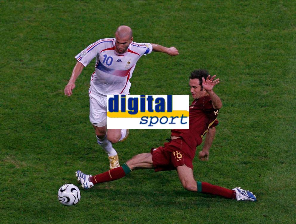 Photo: Glyn Thomas.<br />Portugal v France. Semi Final, FIFA World Cup 2006. 05/07/2006.<br /> France's Zinedine Zidane (L) is tackled by Portugal's Ricardo Carvalho.