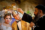 A wedding ceremony in the cave Church of St. Simon the Tanner in the Garbage City.