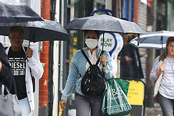 © Licensed to London News Pictures. 14/09/2021. London, UK. A woman wearing a face covering in north London. Later today, Prime Minister, Boris Johnson will outline a 'winter plan' for dealing with an increase in coronavirus infections in the coming months and to avoid another national lockdown. It is expected that compulsory face coverings could be reintroduced in some settings. Photo credit: Dinendra Haria/LNP