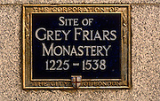 A detail close-up of a City of London sign, locating the site of the former Grey Friars Monastery. In London, the Greyfriars was a Franciscan friary that existed from 1225 to 1538 on a site at the North-West of the City of London by Newgate in the parish of St Nicholas in the Shambles. It was the second Franciscan religious house to be founded in the country. It flourished in the fourteenth and fifteenth century, but was dissolved in 1538 at the instigation of Henry VIII as part of the dissolution of the monasteries.