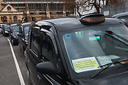 Licensed taxi drivers block the traffic in Parliament Square between 1pm-4pm in protest against traffic policies, 11th of February 2019, Central London, United Kingdom.  The disgruntled taxi drivers feel squeezed by local government transport policies. They say they will continue their protest and blockade the square every other day the same time until they feel the Mayor of London listens to them.