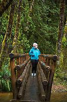 Girl hiking on the Soapstone Lake trail. Oregon.