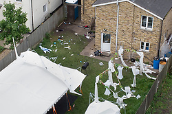 © Licensed to London News Pictures. 24/05/2021. London, UK. The remains of a party and a partially damaged marquee are seen at a property on Consort Road in Peckham south London near where Black Lives Matter activist Sasha Johnson was shot. Ms Johnson remains in a critical condition in hospital after the shooting which happened at 3am on Sunday morning. Photo credit: Peter Macdiarmid/LNP