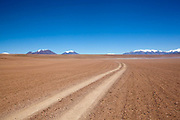 Path stretching off into thr distance in the desert. Salar Uyuni salt flats and Eduardo Avaroa national park, south western Bolivia