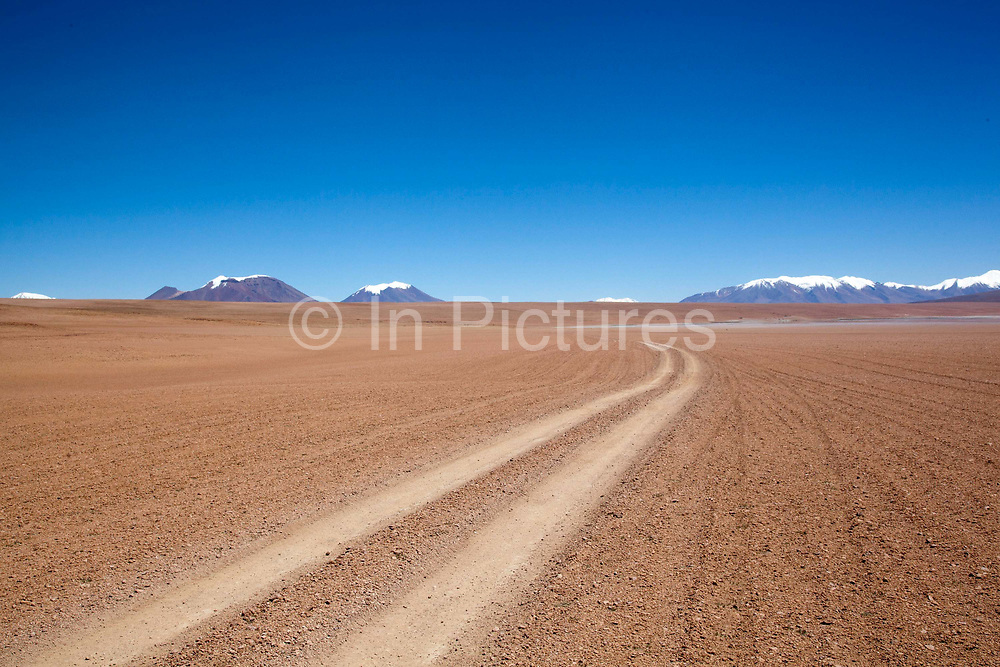 Path stretching off into thr distance in the desert. Salar Uyuni salt flats and Eduardo Avaroa national park, south western Bolivia