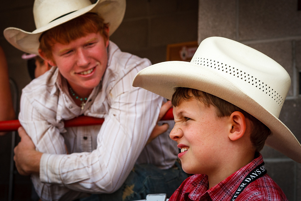 Saddle Bronc rider JACOBS CRAWLEY talks with eight year-old fan, KEATON ANDERSON during the Cheyenne Frontier Days Rodeo.