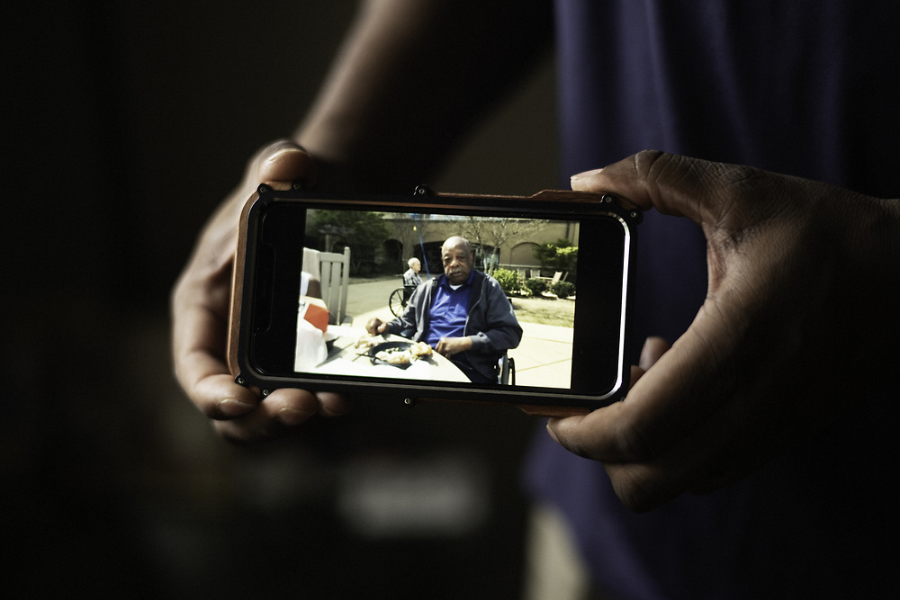BIRMINGHAM, AL – JUNE 9, 2020: Clarence John Hill, Jr. shows a recent photograph of his father, Clarence John Hill, Sr. taken at Bill Nichols State Veterans Home in Alexander City. Hill discovered his father had tested positive for coronavirus only after his death, through a funeral home in Alexander City. CREDIT: Bob Miller for The Wall Street Journal<br /> VETVIRUS