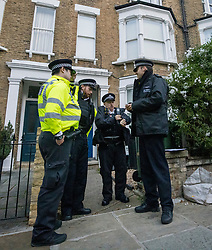 © Licensed to London News Pictures. 17/10/2021. London, UK. Police stand outside the home of Ali Harbi Ali in Kentish Town, North London. Ali Harbi Ali, a 25-year-old Briton of Somali heritage, is currently detained over the killing of MP Sir David Amess at his Southend constituency. Photo credit: Ben Cawthra/LNP