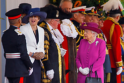 © Licensed to London News Pictures. 12/07/2017. London, UK. UK Prime Minister Theresa May and Queen Elizabeth II chat as they wait to welcome King Felipe VI and Queen Letizia of Spain on Horse Guards Parade in London on the first day of State visit of the King and Queen of Spain. Photo credit: Tolga Akmen/LNP
