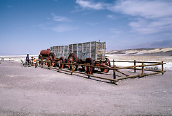 CA: Death Valley National Park, Furnace Creek Ranch, Harmony Borax Works, old borax mining wagons               .Photo by Lee Foster, lee@fostertravel.com, www.fostertravel.com, (510) 549-2202.Image: cadeat212.
