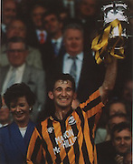 Liam Fennelly becomes the only captain to lift the new and the old McCarthy Cup in 1992.