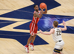 Feb 13, 2021; Morgantown, West Virginia, USA; Oklahoma Sooners guard Umoja Gibson (2) shoots a three pointer during the second half against the West Virginia Mountaineers at WVU Coliseum. Mandatory Credit: Ben Queen-USA TODAY Sports
