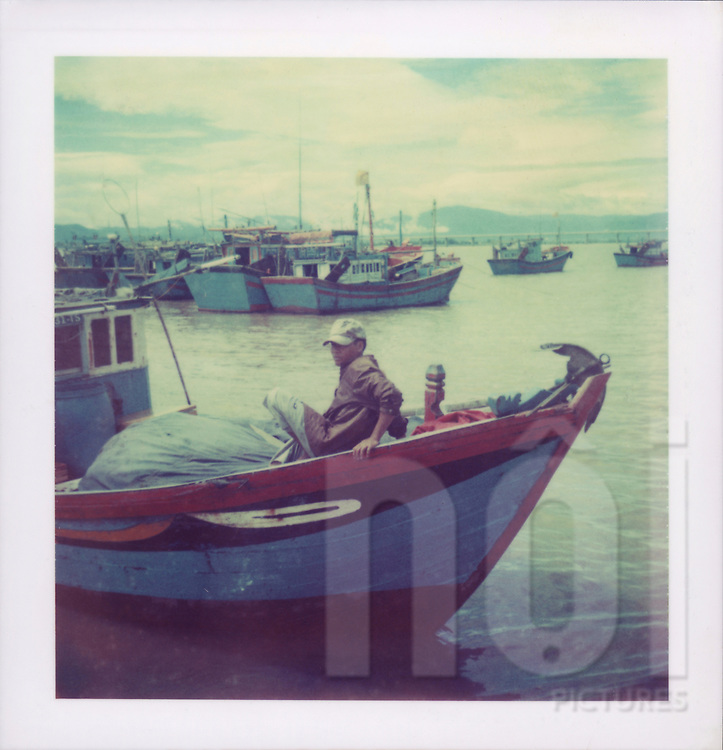 Polaroid 88 of a fisherman in a boat off Vietnam's Central coast, Southeast Asia