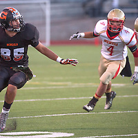 Gallup Bengal Xavier Hoover (85) runs the ball past Espanola Valley Sundevils during the homecoming game at Public School Stadium Friday.